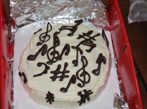 Chocolate music on a flourless chocolate cake.