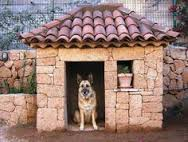 I found this stone dog house online. I especially like the potted plant in the window.